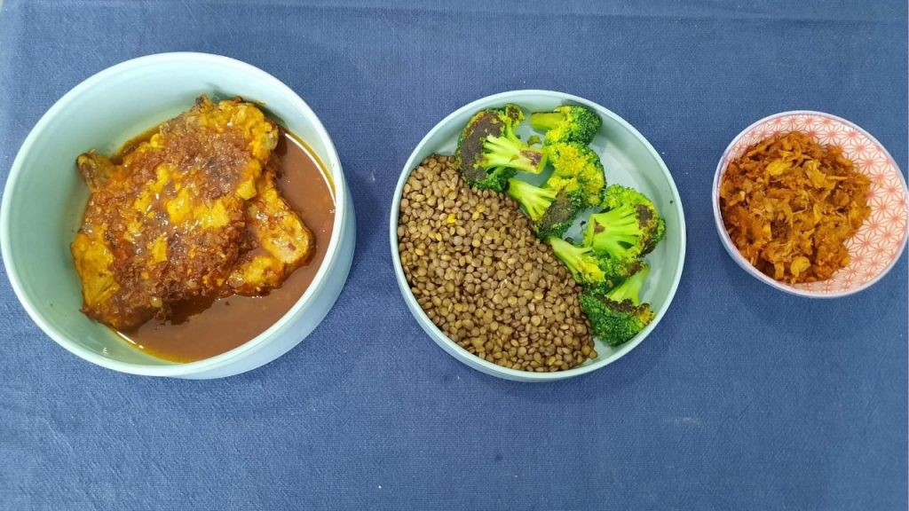 three plates with pork lentils broccoli and pulled pork