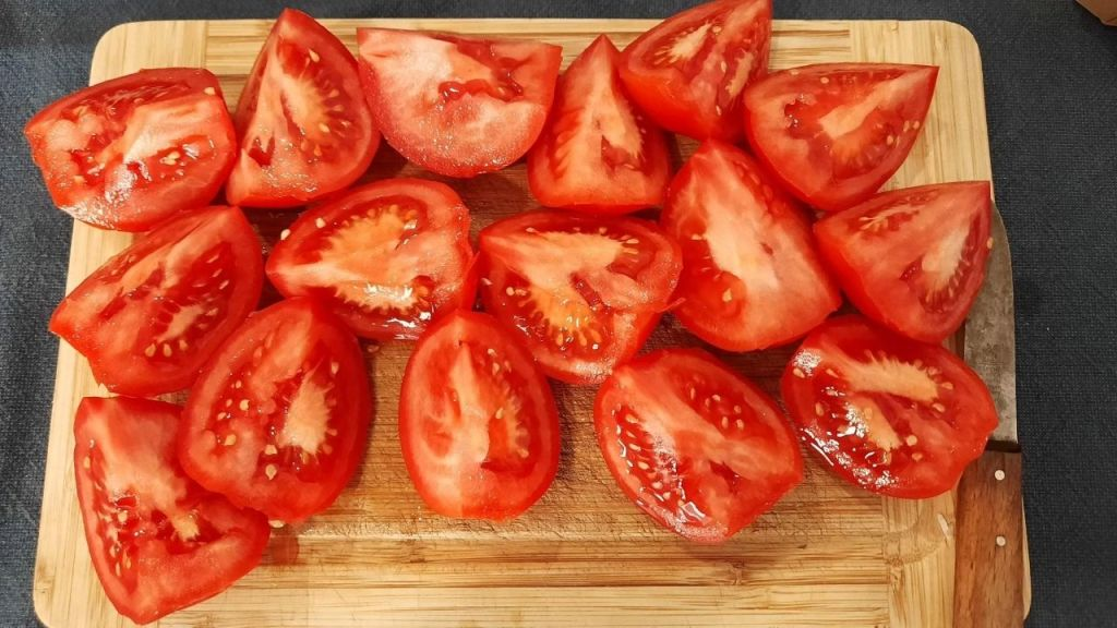 Beautiful, red, ripe tomatoes in pieces