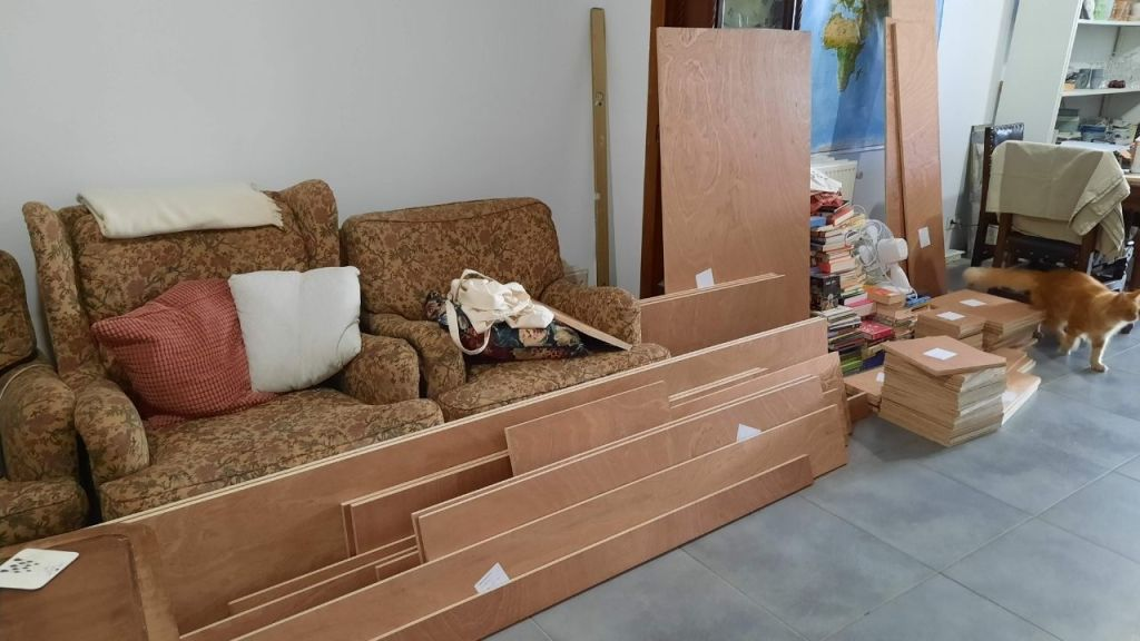 living room with wood for the bookcase