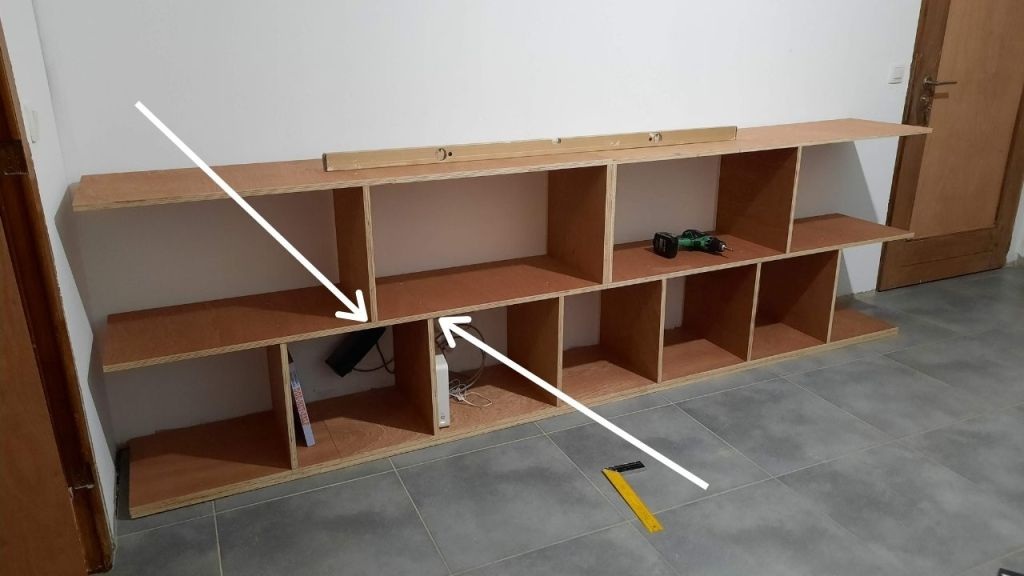 problem vertical shelves with arrows indicating, electric screwdriver, level
