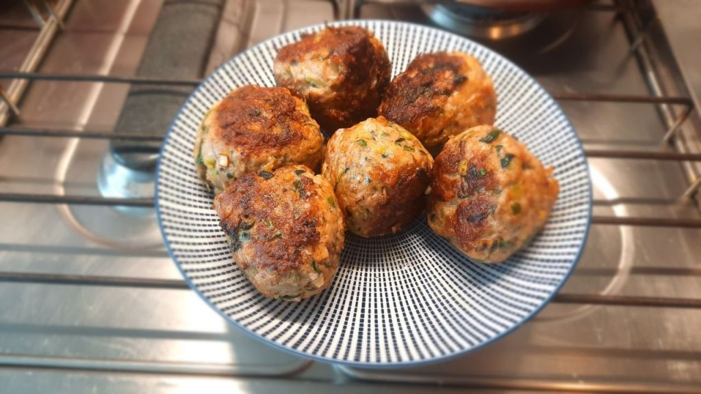 baked meatballs with pieces of courgette